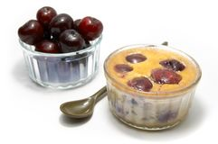 Clafoutis. An individual clafoutis with cherries in a ramequin stock image
