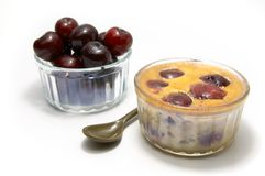 Clafoutis. An individual clafoutis with cherries in a ramequin stock photography