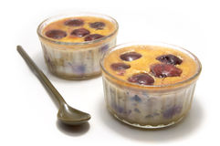 Clafoutis. Two individual clafoutis with cherries in ramequin stock photos