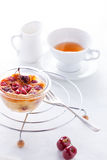 Clafoutis with berries and a cup of tea. Stock Photos
