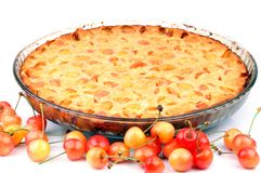 Clafoutis with cherries in a dish on a white background stock photography