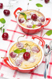 Clafoutis with cherries in ramekin, top view Stock Images