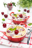 Clafoutis with cherries in ramekin Royalty Free Stock Photos