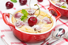 Clafoutis with cherries in red ramekin, close-up Royalty Free Stock Photos