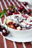 Clafoutis with cherries in a white dish Stock Image