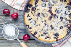 Clafoutis with cherry in baking dish, horizontal, top view Stock Photo