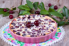 Clafoutis with cherry in ceramic form. Close-up Royalty Free Stock Photography