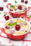 Clafoutis with cherry in the ramekin Royalty Free Stock Photos