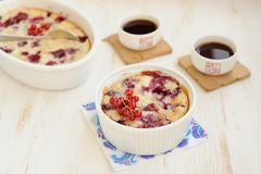 Clafoutis with cherry and red currants. On white background Royalty Free Stock Image