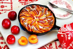 Clafoutis with plums. Clafoutis is a French rustic style dessert. It's somewhere between a cake, a custard and a pancake Royalty Free Stock Photography