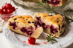 Clafoutis - a traditional French cake with cherries Royalty Free Stock Images