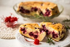 Clafoutis - a traditional French cake with cherries stock images