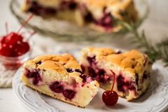 Clafoutis - a traditional French cake with cherries stock photos