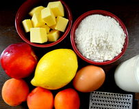 Clafouttis ingredients. Clafouttis ingrediens with peach and apricot Stock Image