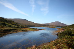 Claggan, County Mayo, Ireland. Scenic landscape of an area of County Mayo located within the province of Connacht in Ireland. Lakes and mountains with blue sky stock photography