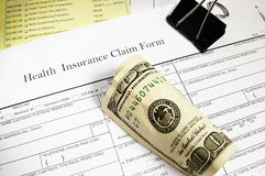 Claim form and cash. Medical insurance claim form, bills and cash Royalty Free Stock Photography
