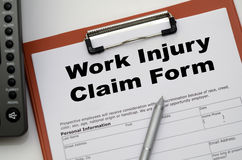 Claim form. For a work injury on a desk top Stock Photos