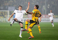 Claiming the ball between players Paok and Aris Stock Image