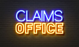 Claims office neon sign on brick wall background. Stock Photos