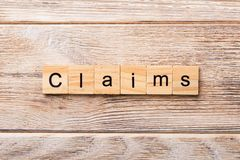 Claims word written on wood block. claims text on wooden table for your desing, concept stock images