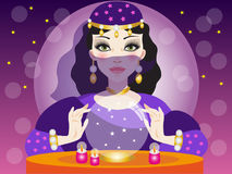 Clairvoyant reads the future in the crystal ball Royalty Free Stock Image