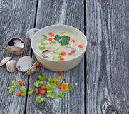 Clam chowder soup on old wood background Royalty Free Stock Photo