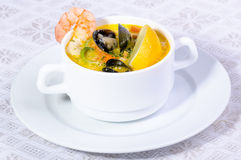 Clam, Fish and Shrimp Soup. Seafood chowder with fish, shrimp, clams and lemon stock images