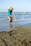 Clam Raking Royalty Free Stock Images