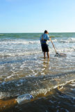 Clam shellfishermen on the coast of Huelva, Andalusia, Spain Royalty Free Stock Images