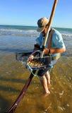 Clam shellfishermen on the coast of Huelva, Andalusia, Spain Stock Photos