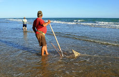 Clam shellfishermen on the coast of Huelva, Andalusia, Spain Royalty Free Stock Photo