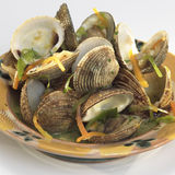 Clam shells in white-wine sauce and root vegetables Stock Image