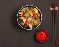 Clam soup. Herbal clam soup Vietnam style served on a black background Stock Image