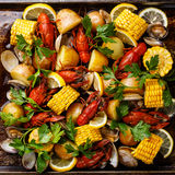 Clambake Seafood boil. With boiled Crayfish, Corn on the Cob, Potatoes and Clams stock photos