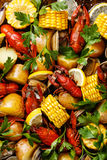 Clambake Seafood boil. With boiled Crayfish, Corn on the Cob, Potatoes and Clams royalty free stock photography