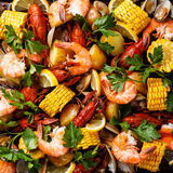Clambake Seafood boil. With Corn on the cob, Potatoes, Prawns, Crayfish and Clams stock photo
