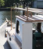 Clamboat moored in a long island canal stock photos