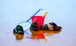 Clamming tools and two pairs of shoes Stock Photo