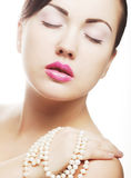 Clamor woman with pearl Stock Photography