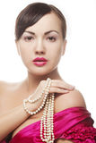 Clamor woman with pearl Stock Image