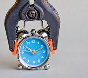 Clamp and clock Stock Image