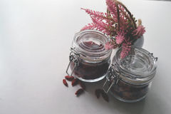 Clamp glass jar with grains. Grains storing in the clamp glass jar royalty free stock photo