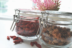 Clamp glass jar with grains. Grains storing in the clamp glass jar stock images
