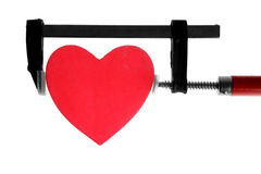 Clamp grip tool pressing red heart Royalty Free Stock Photo