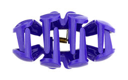 Clamp Hair Clip Tines. A view of the tines of a purple hair clip clamp on a white background Stock Image
