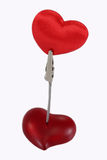 Clamp holding a velvet heart Royalty Free Stock Photo