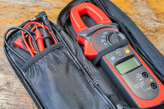 Clamp multimeter with accessories on a table in a workshop Stock Photography
