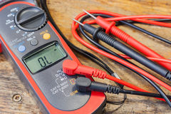 Clamp multimeter with accessories on a table in a workshop Royalty Free Stock Images