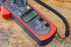 Clamp multimeter with accessories on a table in a workshop Stock Photo