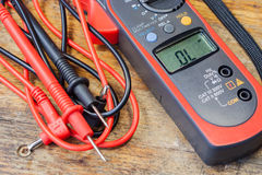 Clamp multimeter with accessories on a table in a workshop Stock Photos